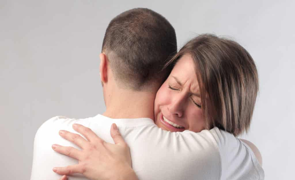 Wife crying with husband